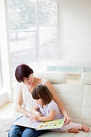 MODEL RELEASED. Mother and daughter reading.