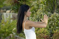 Portrait of a young woman doing yoga in her backyard