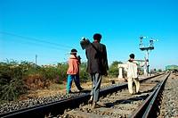 Workers walking in Meterguage railway tracks and signal ; Gujarat ; India