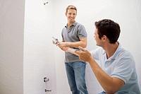 Two men remodeling bathroom