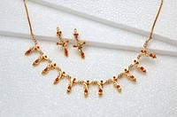 Red coral monga stone with pearls necklace and earrings jewellery set in gold