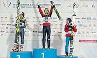 Jaka Hvala of Slovenia, center, greets the audience after he won the men´s ski jump race during Nordic Junior World Ski Championships in Liberec, some...