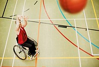 Man in Wheelchair Throwing Basketball