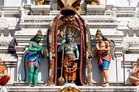 Colorful figures of Lord Vishnu with Hanuman the Monkey God ; Garuda and serpent Shesha on richly decorated facade of Kanak Gopuram of the Udupi Sri K...