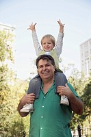 Father carrying son on shoulders