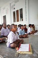 Children studding in Open Class ; Tamil Nadu ; India NO MR ; NO PR