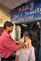 A Young man getting his facial done at Taj hair and beauty saloon  ; Dehradun ; Uttaranchal ; India