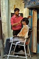 A Young man getting his head massage done at Taj hair and beauty saloon  ; Dehradun ; Uttaranchal ; India
