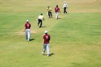 Cricket players playing cricket ; Parsi gymkhana ; Marine Line ; Bombay now Mumbai ; Maharashtra ; India