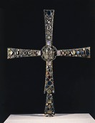 8th century processional cross known as Desiderio's Cross in wood embellished with metal plates, gemstones and vitreous paste insets, 127,5 x 99 cm. G...