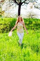 beautiful young girl happy in summer outdoor