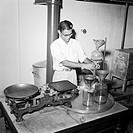 Year 1953 ; separating water from the crude oil which is spooned out ; sandal oil extracting factory ; Mysore city ; Karnataka ; India NO MR