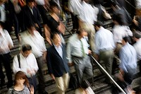 Workers commuting to work at the busy Shinagawa Station in Tokyo Japan