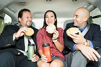 Business People Commuting and Eating Breakfast on the Go