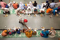 300th year of consecration of Guru Granth Sahib on 30th October 2008 ; Sikh devotees having food at a Langar (traditional community kitchen) at Sachkh...