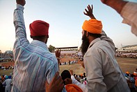 Sikh devotees encouraging players during friendly wrestling match ; cultural events for 300th year´s celebrations of Consecration of perpetual Sikh Gu...