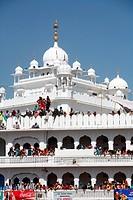 Devotees watching procession of Hola Mohalla festival from Anandpur sahib Gurudwara in Rupnagar district ; Punjab ; India