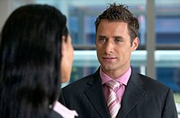 Young Businessman and Businesswoman Talking