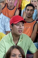 Young Man Watching a Sporting Event