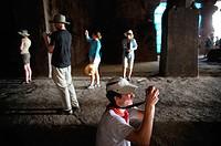 Foreign tourists shooting inside elephanta caves ; Bombay Mumbai ; Maharashtra ; India NO MR