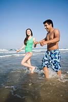 Couple Walking Through the Ocean
