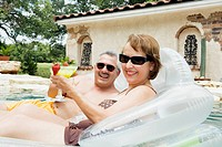 Couple in Pool with Drinks