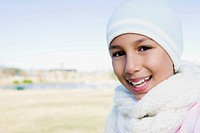 Girl wearing knit cap and scarf