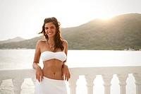 Woman wearing bikini on balcony