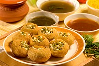 Snacks , pani puri with sprouted mung served in plate with chutney