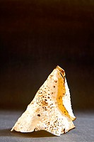 Indian snack roasted papad in cone shape on black background 16-April-2010