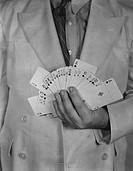 Man holding deck of cards