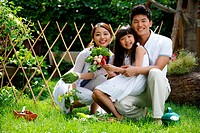 Oriental family outdoors in sunshine