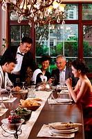 Luxury family having dinner together