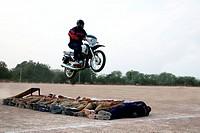 Policeman showing tricks on motorbikes ; Jodhpur ; Rajasthan ; India