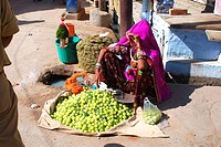 Rajasthani lady selling amla in Pushkar ; Rajasthan ; India