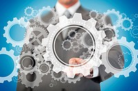 Businessman selecting cogs and wheels graphic