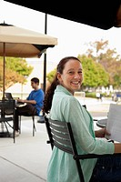 Students studying at tables on campus