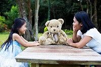 China, Hong Kong, Mother and daughter (8-9) playing in garden