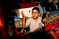 A Salvadorean boy applies makeup before his clown performance at the Circo Brasilia, a family run circus travelling in Central America, 10 May 2011  T...