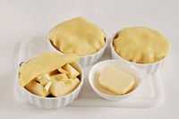 Covering the tartlets with pastry