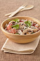 Long grain rice salad with diced bacon,grapefruit,mushrooms and fresh spinach