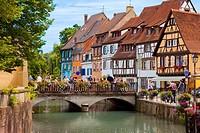 Tourists enjoying the Petite Venise - along the Quai de la Poisonnerie in Colmar, Alsace France