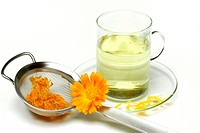 Garden Marigold tea, cup / Calendula officinalis / tea strainer