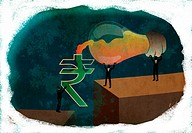 Conceptual shot of business people pouring ideas from light bulb into rupee sign depicting money making