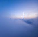 Burj Khalifa rises out of the fog, Dubai, UAE