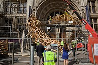 Timber Wave, Installation for London Design Festival 2011, London, United Kingdom. Architect: AL_A, 2011. Sculpture under construction with passersby.