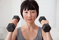 Chinese woman lifting weights