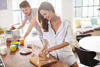 Couple making breakfast in kitchen
