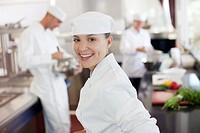 Chef smiling in restaurant kitchen