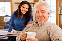Hispanic couple smiling in living room